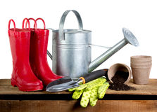 Gardening tools and rubber boots Stock Image