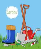 Gardening tools and rubber boots on the grass against the sky isolated Stock Image