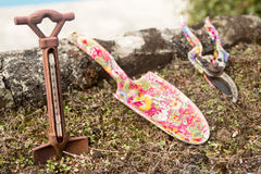 Gardening tools. Set of gardening tools, with nice pink shear and shovel, and an iron thermometer Stock Photo