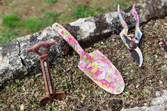 Gardening tools. Set of gardening tools, with nice pink shear and shovel, and an iron thermometer Stock Image