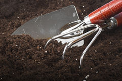 Gardening tools. Set of gardening tools in the soil Royalty Free Stock Photos