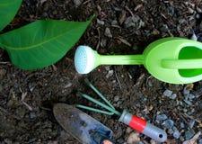 Gardening tools. Set on soil Stock Photos