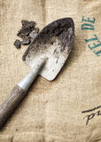 Gardening tools and soil on sack background. Gardening tools and soil on sack texture background Royalty Free Stock Photos