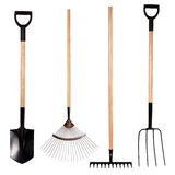 Gardening tools, spade, fork and rake. Isolated on white background Royalty Free Stock Photos