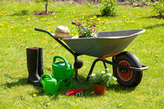 Gardening tools and a straw hat in the garden Royalty Free Stock Image