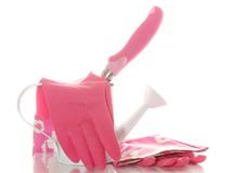 Gardening tools: Watering Can and Gloves Royalty Free Stock Image