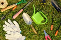 Gardening tools and watering can on grass Stock Photos