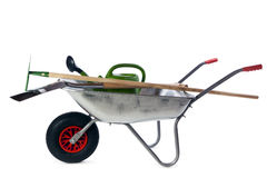 Gardening tools in wheelbarrow isolated Stock Image