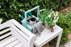 Gardening tools on white wooden table and bench Royalty Free Stock Images