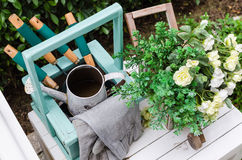 Gardening tools on wooden table in garden Royalty Free Stock Photo