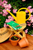 Gardening tools on wooden table and rose flowers background Stock Photo