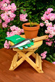 Gardening tools on wooden table and rose flowers background Royalty Free Stock Image