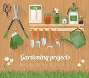 Gardening tools on a wooden wall Stock Photo