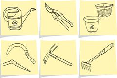 Gardening tools on yellow memo sticks Royalty Free Stock Photography