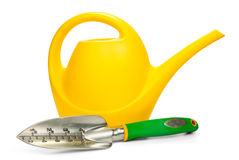 Gardening Tools. Yellow watering can and trowel on a white background Royalty Free Stock Photo