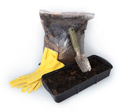 Gardening trowel, gloves, bag with peat Royalty Free Stock Images