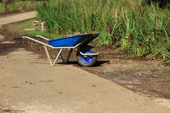 Gardening in the unicycle、cut grass in the garden.. Wheelbarrow with cut grass in the garden. a park. cart one wheel Royalty Free Stock Photos
