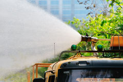 Gardening water pouring with vehicle tube Royalty Free Stock Photos