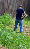 Gardening and weed whacking Stock Photos