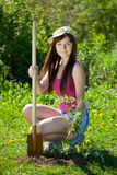 Gardening woman. Young woman working in garden with spade and sprouts  in spring Royalty Free Stock Image