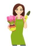 Gardening woman. Gardening beautiful woman holding hyacinth flowers pot Stock Photography