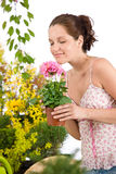 Gardening - woman holding flower pot Royalty Free Stock Photos