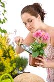 Gardening - woman holding flower pot and shovel Stock Image