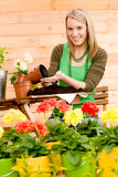 Gardening woman plant spring flower terrace Stock Photos