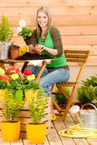 Gardening woman plant spring flower terrace Stock Photo