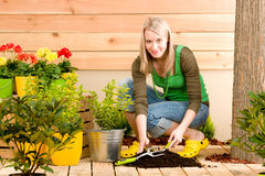 Gardening woman plant spring flower terrace Royalty Free Stock Photo