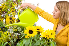 Gardening - woman pouring water to flowers Royalty Free Stock Photos