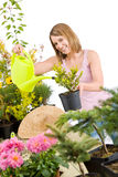 Gardening - woman pouring water to plant Royalty Free Stock Image
