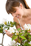 Gardening - woman with Rhododendron flower Royalty Free Stock Image