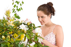 Gardening - Woman with Rhododendron flower blossom Royalty Free Stock Photography
