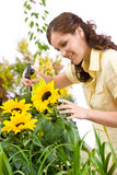 Gardening - woman sprinkling water Royalty Free Stock Photos