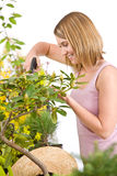 Gardening - woman sprinkling water to plant Stock Photos