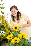 Gardening - woman with sunflower Royalty Free Stock Photography