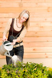 Gardening woman watering plant spring terrace Royalty Free Stock Photography