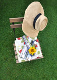 Gardenlife - calm day reading magazines. Warm day in the garden during Summer. Straw hat and some magazines makes my calm day complete stock image