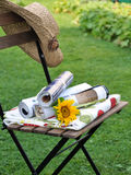 Gardenlife - calm day reading magazines. Warm day in the garden during Summer. Straw hat and some magazines makes my calm day complete royalty free stock image