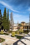 Gardens of Alhambra. Gardens located inside the wonder of the Alhambra Nasrid located in the Spanish city of Granada, we can see a pond  and the background a Royalty Free Stock Photos
