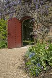 Gardens at Arundel Castle in Sussex. ARUNDEL, UK - MAY 5TH 2018: A doorway in the beautiful gardens at Arundel Castle in West Sussex, UK, on 5th May 2018 Stock Photos