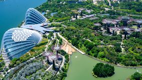 Gardens by the Bay, Singapore, Asia. Aerial view of Flower Dome, Cloud Forest and Park with Supertrees.