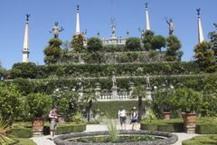 Gardens of Borromeo Palace on Isola Bella, Stresa. Tourists walking around the gardens of Palazzo Borromeo on Isola Bella,Stresa,Lake Maggiore,on a sunny day and Royalty Free Stock Photography