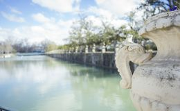 Gardens of the city of Aranjuez, located in Spain. Stone palace. And beautiful autumn landscapes with beautiful fountains and mythological figures Stock Images