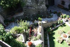 Gardens in Monasteries in Greece. Gardens with different flowers in Monasteries on Meteora Rocks, Trikala region, Greece stock photo