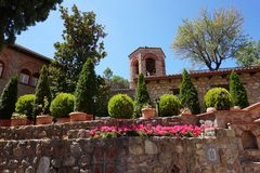 Gardens in Monasteries in Greece. Gardens with different flowers and plants in Monasteries on Meteora Rocks, Trikala region, Greece royalty free stock photography