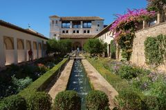 Gardens and fountains of Generalife Palace, Granada, Spain. The gardens of the Generalife Palace lie within the Alhambra complex of palaces, battlements and Royalty Free Stock Image