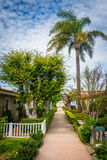 Gardens and houses along walkway royalty free stock photos