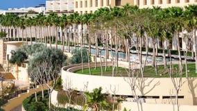 Gardens of Kempinski resort hotel on Dead Sea. DEAD SEA, JORDAN - FEBRUARY 19, 2012: gardens of Kempinski resort hotel Ishtar on Dead Sea in sunny winter day. It Royalty Free Stock Image